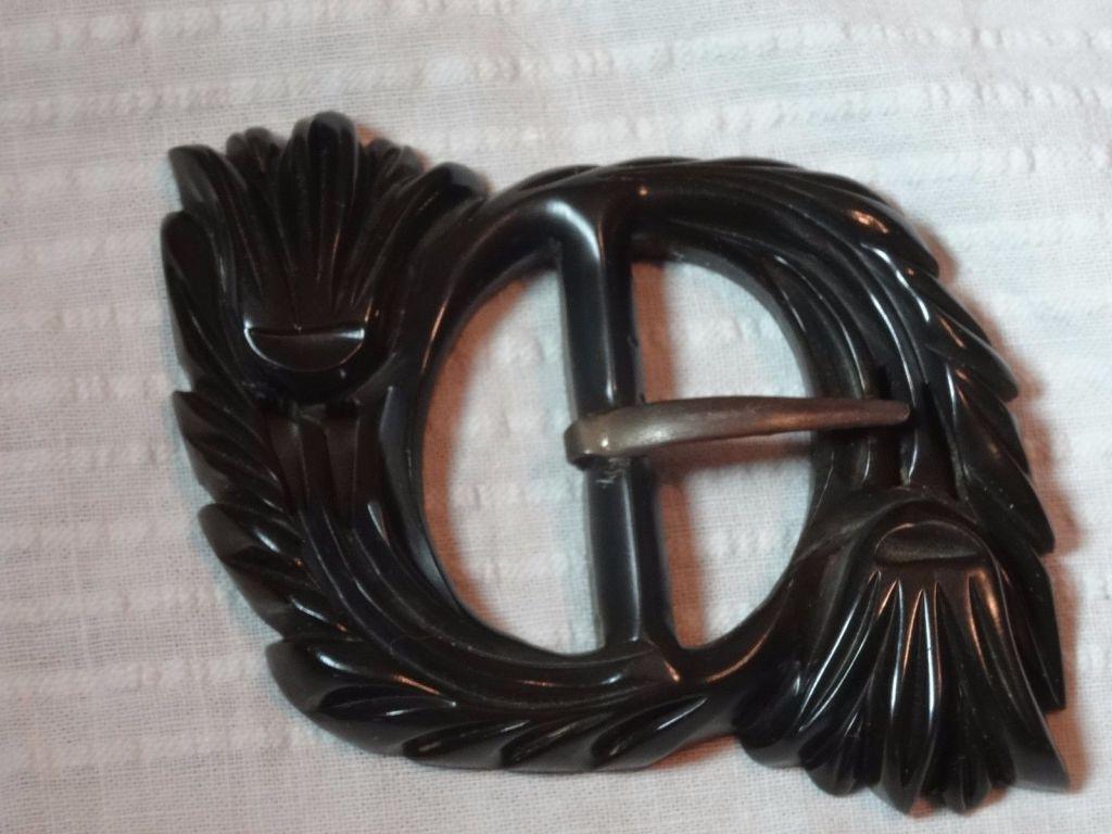 carved bakelite buckel